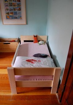 Toddler beds may not be for everyone, but as it turns out, they're for my toddler. Here's the saga of a preternaturally agile and stubborn (though still adorable) little boy, a semi-frustrating trip to Ikea, and a very handy husband who saves the day: