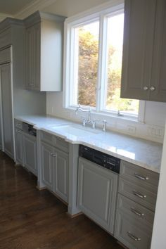 Yummm on the gray cabinets with white marble.