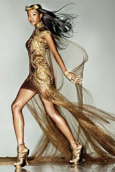 Nothing more powerful than a woman in gold - especially if she's Naomi Campbell!