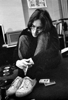John Lennon with some 45 rpm vinyl records, uncredited