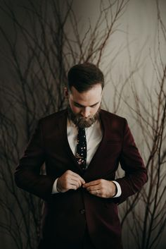 Burgundy velvet groom's jacket | Image by Drea Dawn Photo + Films