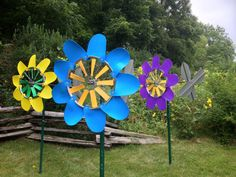 Windflowers from Windworker Studio. Kinetic garden sculptures shown at Paoli, WI Art in the Mill Park show.