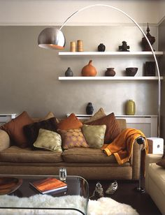 Color Scheme for my ideal living room. Orange, green, and a grayish brown. :)