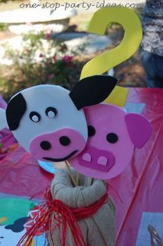 Animal centerpiece for a barnyard birthday party. See more farm and birthday parties for kids on www.one-stop-party-ideas.com