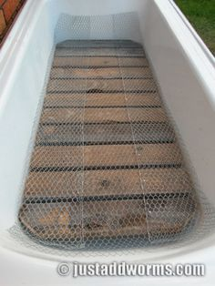 How to make a Bathtub Worm Farm in Eight Easy Steps. Chicken Mesh Laid Over Wooden Grate
