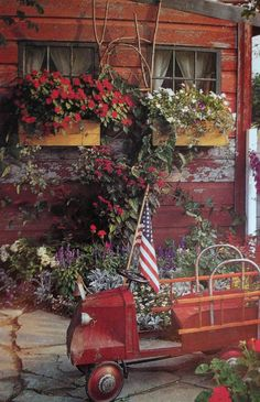 Country Garden...flower boxes 'n such...old child's firetruck with a flag.
