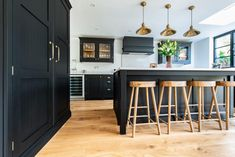 We recently fitted this beautiful bespoke kitchen for a lovely couple in Kent. The dark cabintery is hand painted in Mylands 'Sinner' and finished with brass handles and hinges. This kitchen is in our Westminster range - a classic framed shaker style. Open Plan Kitchen Diner, Open Plan Kitchen Living Room, Open Concept Kitchen, Kitchen And Bath, New Kitchen, Kitchen Black, Kitchen Modern, Dining Room, Kitchen Interior