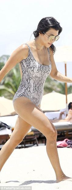Beach babe: Kourtney looked great in a grey snakeskin one-piece while enjoying a Fourth of July weekend in Miami