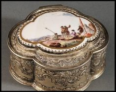 Patch Boxes | Early small boxes called patch boxes are frequently confused with snuff boxes. In all honesty, I am not sure how you determine the difference with 100% certainty. A patch box usually contained a cloth or taffeta. This cloth would be used as a concealer for the body or face. Or it was simply worn as a decorative flourish. Patch boxes are high collectible. They were made and used during the same time period as snuff boxes.