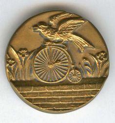 Pegs Button Blog--Bird riding a bicycle, antique brass button