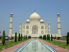 """photo by keziacw on Flickr.  The Taj Mahal is a white Marble mausoleum located in Agra, India. It was built by Mughal emperor Shah Jahan in memory of his third wife, Mumtaz Mahal. The Taj Mahal is widely recognized as """"the jewel of Muslim art in India and one of the universally admired masterpieces of the world's heritage."""""""