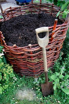 attractive compost bin   Compost Bin woven of wicker, with garden shovel and finished compost