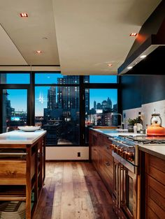 Wonderful lighting in this kitchen.  And that view!!  (This apartment is in Brooklyn)