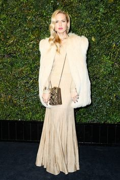 - Our editor in chief Rachel Zoe was a vision in a gold Chanel dress and bag, complemented by David Webb jewelry and a perfectly sleek Veronica Lake-esque 'do.