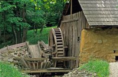 [ROMANIA.TRANSYLVA 23.776] 'Watermill with busnita.'    	Fulling mill with 'busnita' (whirlpool washing device) from Românesti village, now in the Sibiu open air museum. (See also  picture nr 23.769 and 23.770.) Photo Mick Palarczyk.