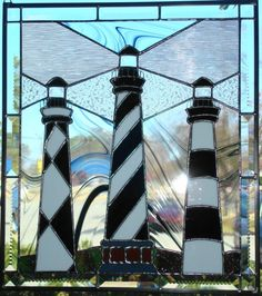 Stained Glass North Carolina Lighthouse Trio Stained Glass North Carolina Lighthouse Trio Cape Hattreas Cape Lookout and Bodie Island Stained Glass Light, Stained Glass Paint, Stained Glass Designs, Stained Glass Panels, Stained Glass Projects, Stained Glass Patterns, Mosaic Glass, Glass Art, Nc Lighthouses