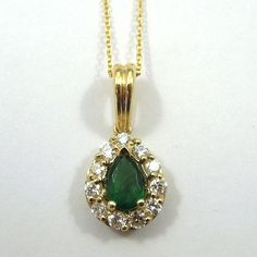.50 Carat Pear Cut Emerald with .45 Total Carat Weight in Accent Diamonds. Set in 14K Yellow Gold.   - $1750