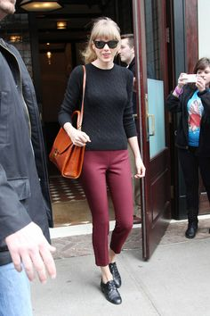 Taylor Swift deep red skinny trousers and crewneck jumper