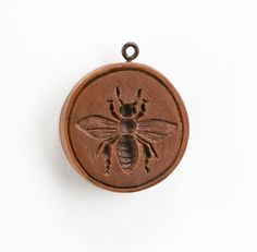 "Always a favorite, our Bee Happy Cookie Mold is 2¼ inches in diameter. Each mold is sold individually and comes with a recipe book ""Too Pretty to Eat"" published by House on the Hill. Cookie molds were"