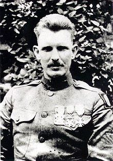 Sergeant York - After his platoon suffered heavy casualties and 3 other noncommissioned officers had become casualties, then-Corporal York assumed command. Fearlessly leading 7 men, he charged with great daring a machine gun nest which was pouring deadly and incessant fire upon his platoon. In this heroic feat the machine gun nest was taken, together with 4 officers and 128 men and several guns. As well as being awarded the Medal, he became a national hero. October 8, 1918