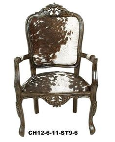 Cowhide chair... Maybe paint the wood turquoise and destress it?!