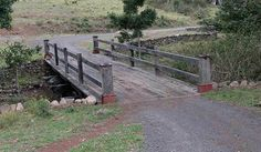 STRONGBUILD Custom Structures.  Recycled timber bridge.