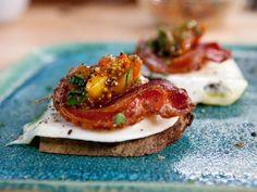 Olive Oil Poached Eggs on Toasted Sourdough with Crisp Pancetta and Tomato-Mustard Seed Relish - Bobby Flay