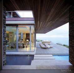 Interior/exterior overflow at Cove 6 House near Knysna, South Africa by SAOTA and Antoni Associates Indoor Outdoor Living, Outdoor Areas, Outdoor Chairs, Exterior Design, Interior And Exterior, Villa, Cabana, Porches, Interior Architecture