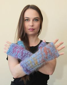 This Long Blue Fingerless Gloves are hand knit by me out of classic yarn mix of mohair and acrylic yarn. Soft and light weighted yet very warm and cozy due to the quality of the classical long haired mohair. Casual romantic feminine and warm accessory for the cold weather. Leaving your fingers free that makes them practical and wearable.  Knit in circle, no sewing.    Fit almost all hand sizes.  They make a lovely elegant warm gift for christmas, birthday and cold weather time…