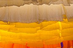 Skeins of fabric hung to dry in the dyer's souk, Marrakech, Morocco, North Africa