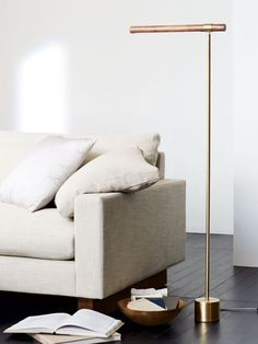 #livingroom #shadesofwhite   Modern living room with LED floor lamp on Thou Swell @thouswellblog  http://www.justleds.co.za