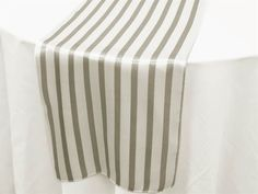 Stripes never go out of style - and for your #winter #wedding reception, these Lovable Satin Stripes Table Runners in Silver & White would add the perfect touch of elegance to your tablescape!