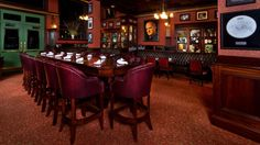 Mahogany leather-upholstered chairs and a long table in an alternate dining room