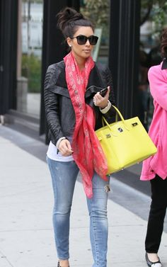 Kim Kardashian's layered/casual look here: Rick Owens jacket, Alexander McQueen scarf, Hermes bag, oversized sunglasses.