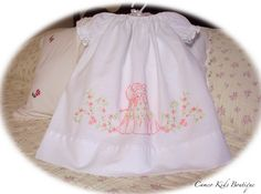 https://flic.kr/p/6MwaRB | Vintage Peasant Style Pillowcase Dress Belle | This little vintage pillowcase dress was made in the peasant style.  This has a beautiful southern belle hand embroidered on the front in a peach color with green vines and leaves, and pretty peach flowers surrounding her.  Another cutie.  www.cameokids.ecrater.com