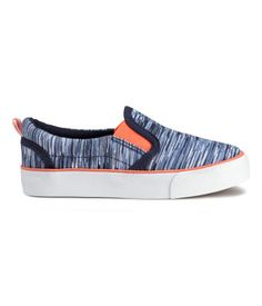 Blue melange. Slip-on shoes in cotton canvas with a printed pattern. Lightly…