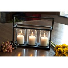 You'll be hoping the power goes out when you're prepared with this lovely triple candle holder with a rustic iron frame. This hurricane lamp holds three votive candles to produce ample light, and the glass covers protect the flames from gusts of wind.