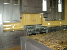 I have fallen in love with painted glass back splashes!   This is a gold back painted glass backsplash.