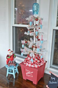 reproduction feather tree decorated for Christmas with vintage bulbs