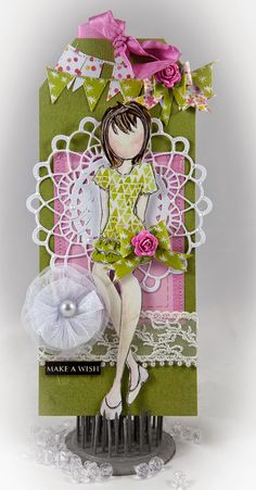 Dear Bloggers,  I had lots of fun creating tags using Julie Nuttings Prima Doll stamps.  This time I stamped 'Dita' and used the girly and ...