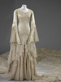 Wedding dress by Norman Hartnell c.a. 1933,  Medium: silk satin, satin applique, tulle, pearl and glass beads, tulle, wax, wire.  Given by Margaret, Duchess of Argyll.