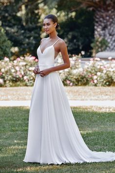 24975 - Shelby -  Simple yet elegant, this Chiffon A-Line gown features a mikado bodice with illusion cut outs. The mikado belt at the waistline completes the look. Try this beauty on at Aurora Bridal in Melbourne, FL 321-254-3880