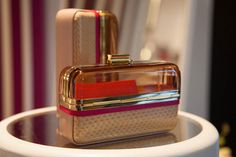 DECO COLLAGE MINAUDIERE  Mixed inaudiere with Gold signature claps. Lined in leather. Colour Beige Quartz and Fuchsia. Discover more at www.hollywood.ferragamo.com
