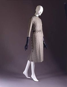 Christian Dior Haute Couture Trompette dress from spring/summer 1950. Made from gingham patterned wool in interesting design of long sleeve suit petal style dress with button and godet insert at the back of the dress. #ChristianDior #Dior.