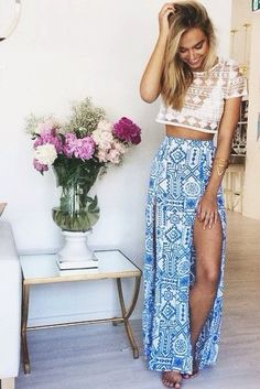 Blue aztec maxi skirt with slots along the legs and a see through crochet crop top with white bra underneath