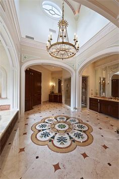 What an amazing bathroom floor! Enormous room with incredible architectural details.