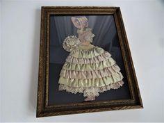 Southern Belle Ribbon Art Paper Doll Vintage 1920s Framed Satin Ruffles Lace  $28  https://www.rubylane.com/item/676693-D17-8/Southern-Belle-Ribbon-Art-Paper-Doll?search=1