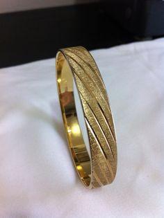 "Vintage stamped Monet gold tone bangle bracelet. 8 1/2"" 1950's era. on Etsy, $17.00"