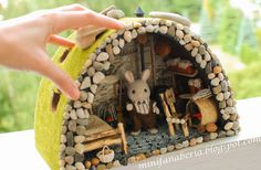 (Translation from Polish): Apartment for a Sylvanian rabbit. Cabin dimensions are 26x14x18cm (1/16-1/18 scale.) On the main wall I used the bark & twigs; shelves are done with bamboo root. All pieces of furniture are hand made, together with the heater. The bedding was sewn with drobnowzorkowych fabric, & recently won a competition.  (from miniaturowy Swiat Lady) See items on Etsy:https://www.etsy.com/shop/MiniFanaberia?ref=shopsection_shophome_leftnav