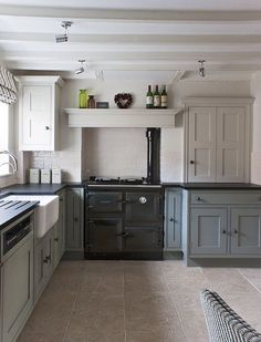 Wonderful kitchen design with in-frame cabinets and an amazing Rayburn. The colours work so well together!